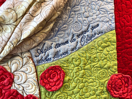 detail of a miracle with roses quilt