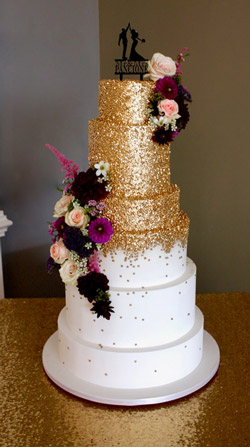 Tiered cake with edible gold