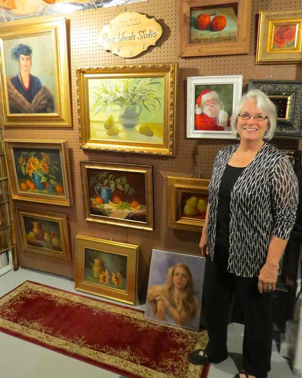 Linda Goddard with her paintings