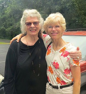 Janet Taylor with Linda Neel in parking lot at Penland School of Craft