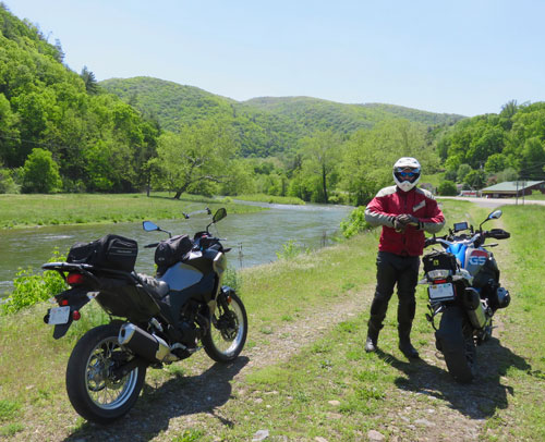 Two motorcycles in scenic setting
