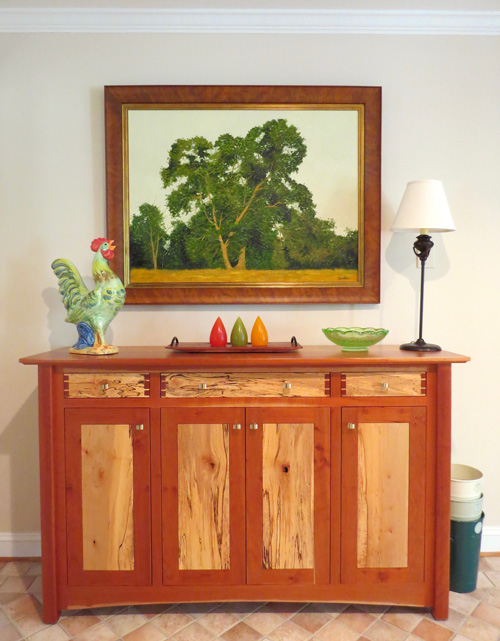 Decorating with art like Big Fella by Tom Neel shows a love of nature, trees, or family.