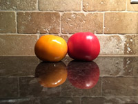 #1  Tomatoes on black granite counter