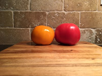 #3  Tomatoes on wet cutting board