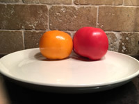 #9  Tomatoes on white ceramic plate